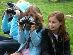 Young Birders practicing focusing with binoculars