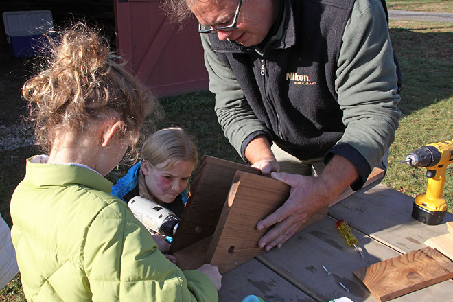 Young Birders building nestbox.  Photo by Adrian Binns (pictured on right).