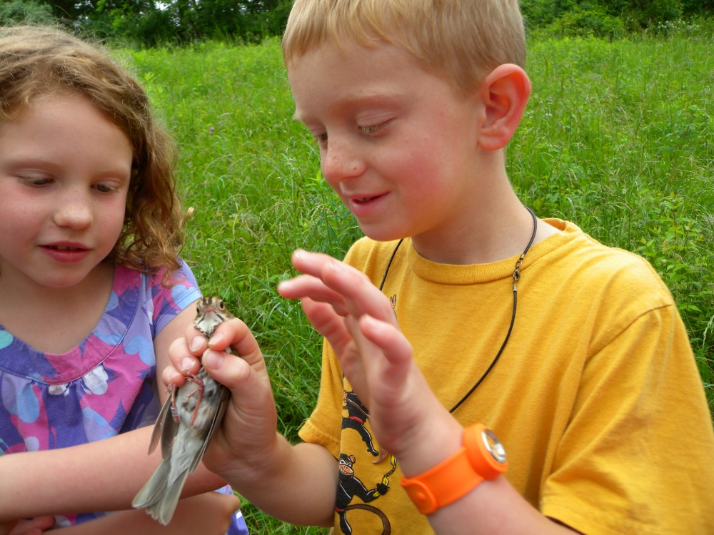 Westtown 1st graders holding Ovenbird before release.  Photo by Blake Goll