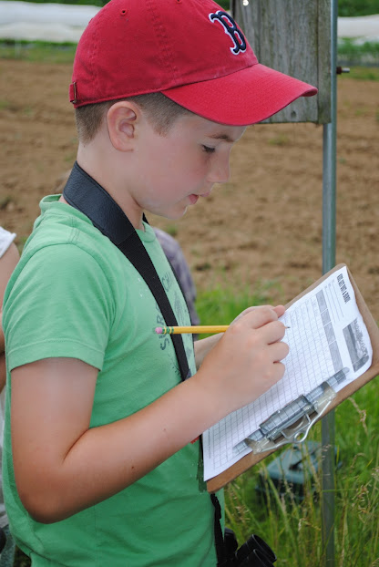 Young Birder taking nest data.  Photo by Gloria Ives