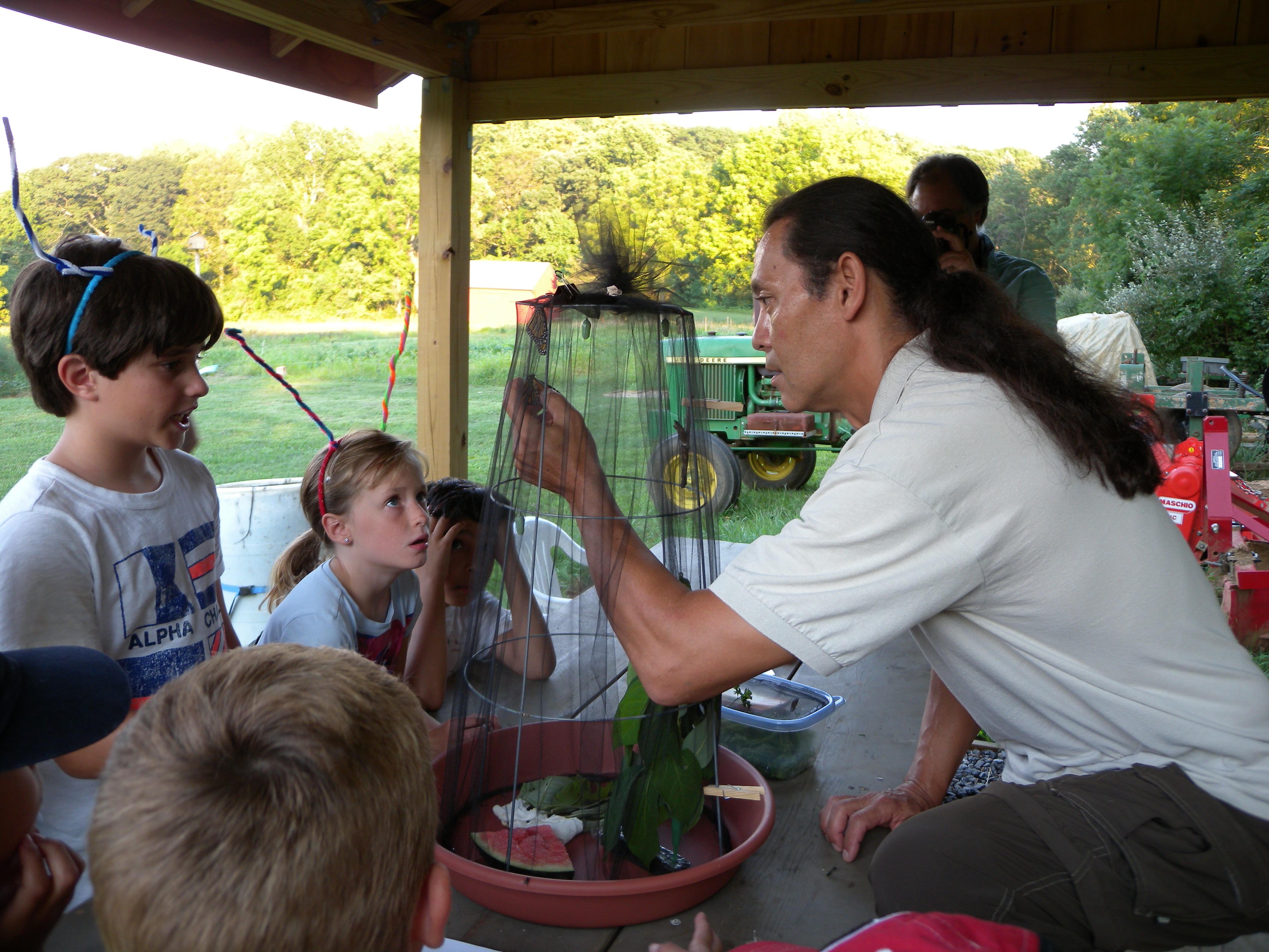 John Black showing Young Birders a Monarch butterfly.  Photo by Blake Goll.