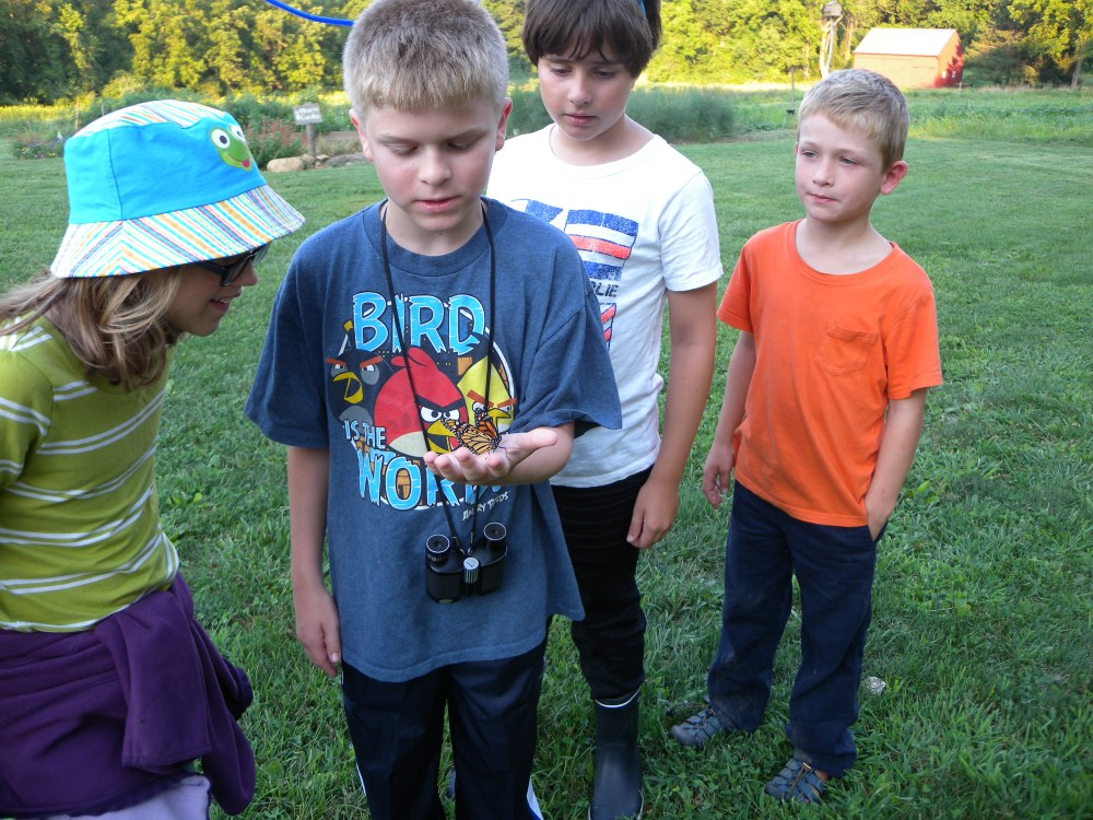 Young Birders releasing a Monarch Butterfly.  Photo by Blake Goll.