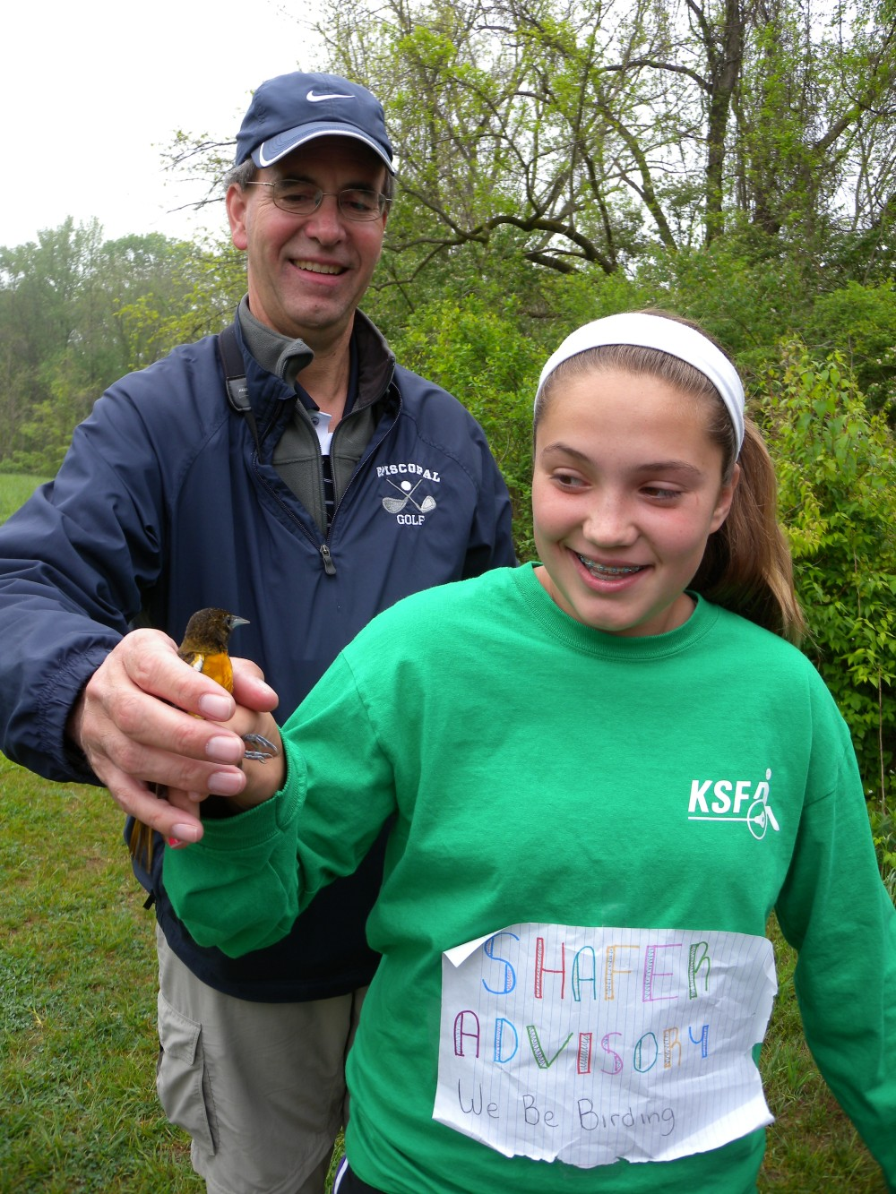 Episcopal Academy teacher and advisee with Baltimore Oriole female before release.  Photo by Blake Goll