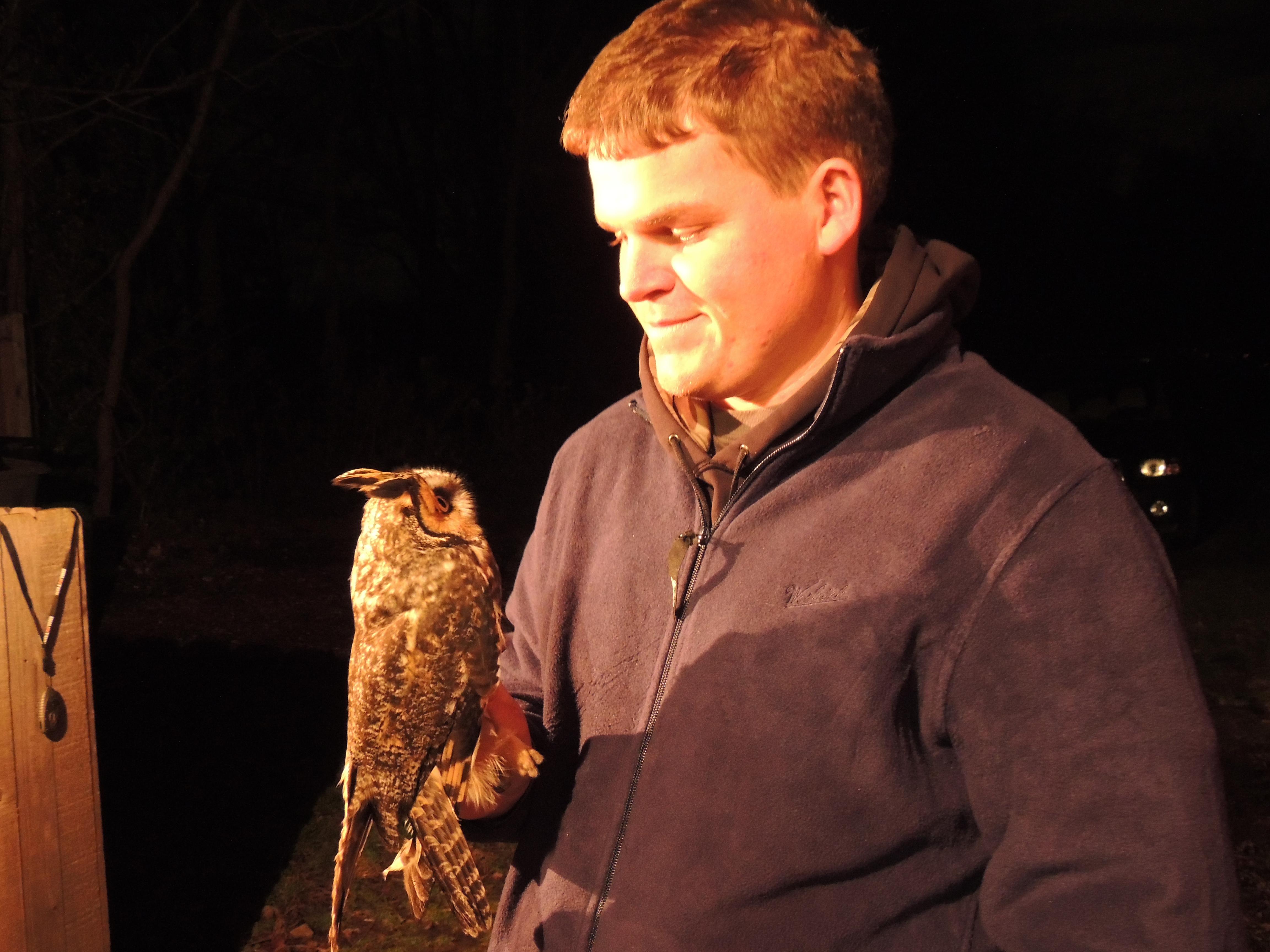 Bracken Brown with Long-eared Owl.  Photo by Art McMorris.