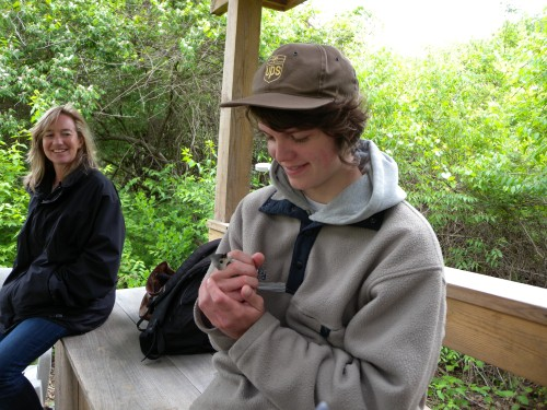 High School intern with Tufted Titmouse before release.  Photo by Blake Goll.