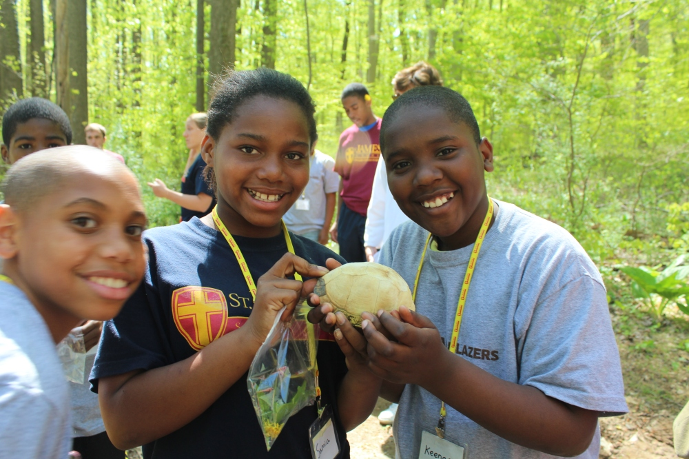 Saint James students with Box Turtle shell in Rushton woods.  Photo by Kelsey Lingle.